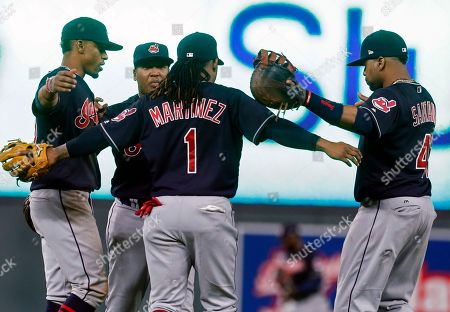 Francisco Lindor, Jose Ramirez, Michael Martinez, Carlos Santana Cleveland Indians players celebrate the team's 11-4 win over the Minnesota Twins in a baseball game, in Minneapolis. From left are Francisco Lindor, Jose Ramirez, Michael Martinez and Carlos Santana