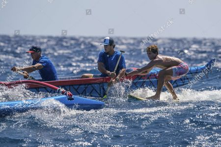 Kai Lenny performs a hydrofoil demo at Downwind Voyage for Change in Hawaii