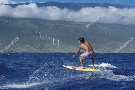 Stock Picture of Kai Lenny performs a hydrofoil demo at Downwind Voyage for Change in Hawaii