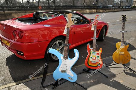 """(L-R) Bender Distortercaster by Brian Eastwood. Est £1,800-2,200. Fender Squier Stratocaster George Harrison """"Rocky"""" recreation. Est. £650-850. 1952 Gibson Les Paul owned by UK guitar legends Duster Bennett, Peter Green of Fleetwood Mac and Eric Clapton. Est. Refer to department. Ferrari Superamerica owned by Rod Stewart.  Est. £70,000-85,000"""