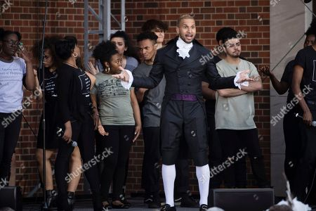 """Sydney James Harcourt, an original cast member from the Broadway musical """"Hamilton"""" performs with students from the Philadelphia High School for the Creative and Performing Arts during opening ceremonies for the Museum of the American Revolution in Philadelphia"""