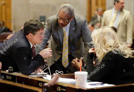 Mike Stewart, Larry Miller, Sherry Jones Rep. Mike Stewart, D-Nashville, left, confers with Rep. Larry Miller, D-Memphis, center, and Rep. Sherry Jones, D-Nashville, right, during debate on Gov. Bill Haslam's road and bridge funding bill, in Nashville, Tenn