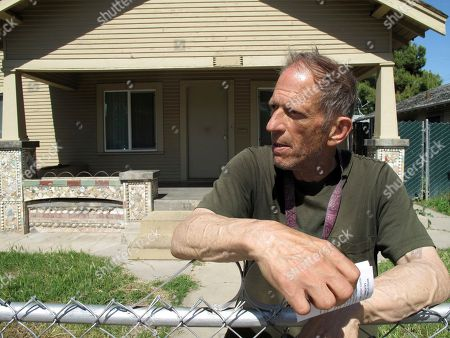 Mark Greer is shown at his home, in Fresno, Calif. He lived there with his best friend and roommate, David Jackson, who was gunned down in a series of random shootings that left a few people dead