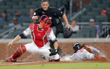Anthony Recker, Anthony Rendon Washington Nationals' Anthony Rendon (6) scores ahead of the tag from Atlanta Braves catcher Anthony Recker (20) on a Adam Lind base hit in the ninth inning of a baseball game, in Atlanta
