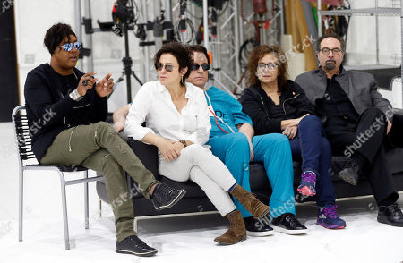 Stock Photo of Wendy Melvoin, BrownMark, Matt Fink, Lisa Coleman, Bobby Z Bassist BrownMark, left, answers a question as the original members of Prince's 1980's band, The Revolution, from second left, guitarist Wendy Melvoin, keyboarders Matt Fink and Lisa Coleman and drummer Bobby Z, look on during an interview, in Minneapolis. The group is preparing to kick off a spring U.S. tour with a performance Friday, the first anniversary of the Prince's death from an accidental overdose