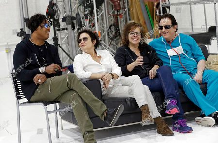 Wendy Melvoin, BrownMark, Matt Fink, Lisa Coleman Four original members of Prince's 1980's band, The Revolution, appear before an interview, in Minneapolis. The group, from left: bassist BrownMark, Guitarist Wendy Melvoin, keyboarders Lisa Coleman and Matt Fink, is preparing to kick off a spring U.S. tour with a performance Friday, the first anniversary of the Prince's death from an accidental painkiller overdose