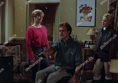 Chris turns the television up as Kathy and Lynn chat around him. Lynn, Kathy and Chris argue when Kathy asks him to turn the television own and he refuses - with Chris Tate, as played by Peter Amory ; Lynn Whiteley, as played by Fionnuala Ellwood, and Kathy Tate, as played by Malandra Burrows. (Ep 1863 - 26th April 1994).