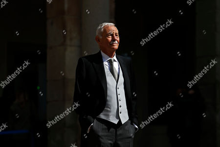 Spanish writer Eduardo Mendoza poses for the media before he was awarded the Cervantes Prize during a ceremony at the University of Alcala de Henares, outskirts Madrid, Spain,. The Cervantes prize is the Spanish-speaking world's highest literary honor