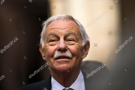 Spanish writer Eduardo Mendoza smiles as he talks to the media before he was awarded the Cervantes Prize during a ceremony at the University of Alcala de Henares, outskirts Madrid, Spain,. The Cervantes prize is the Spanish-speaking world's highest literary honor