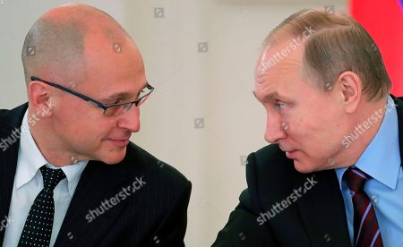 Russian President Vladimir Putin, right, speaks to Presidential first deputy chief of staff Sergei Kiriyenko at a meeting of the Pobeda (Victory) Organizing Committee in the Kremlin in Moscow, Russia