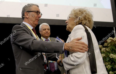 Madrid's Mayoress, Manuela Carmena, greets Brussels' Mayor, Yvan Mayeur (L), as she attends the second day of the 'World Forum on Urban Violence and Education for Better Living and Peace' in Madrid, Spain, 20 April 2017.