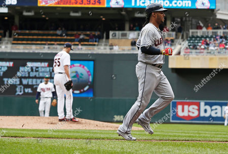 Michael Marinez, Taylor Rogers Cleveland Indians' Michael Martinez jogs home with the go-ahead run after teammate Michael Brantley drew a bases loaded walk by Minnesota Twins pitcher Taylor Rogers, left, in the seventh inning of a baseball game, in Minneapolis. The Indians won 6-2