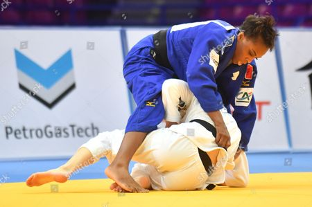 Stock Image of Theresa Stoll (white) of Germany and Priscilla Gneto (blue) of France in action during the final of the -57 kg women category during the European Judo Championships 2017 at Torwar Hall in Warsaw, Poland, 20 April 2017.