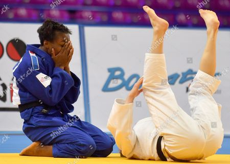 Theresa Stoll (white) of Germany and Priscilla Gneto (blue) of France during the final of the -57 kg women category during the European Judo Championships 2017 at Torwar Hall in Warsaw, Poland, 20 April 2017.