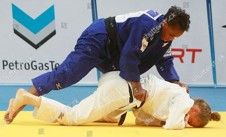Priscilla Gneto, Theresa Stoll Priscilla Gneto of France,up, fights against Theresa Stoll of Germany to win the gold medal in the women's under 57kg competition during the European Judo Championships in Warsaw, Poland