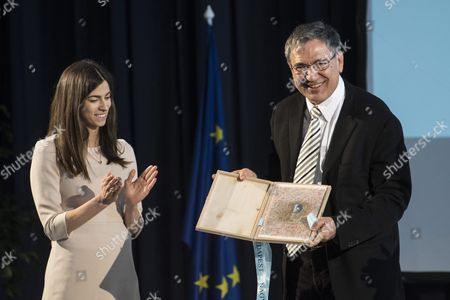 Honorary guest, Turkish author and recipient of the 2006 Nobel Prize in Literature, Orhan Pamuk shows his award, the Budapest Grand Prix after he took it over from Deputy Mayor of Budapest Alexandra Szalay-Bobrovniczky (L) during the opening of the 24th Budapest International Book Festival  in the Millenaris Park, in Budapest, Hungary, 20 April 2017.