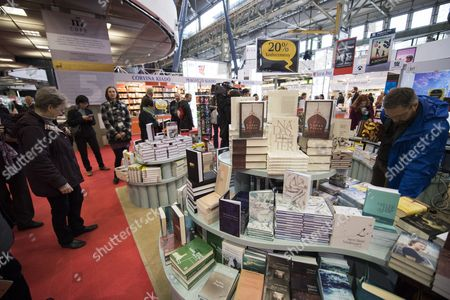 Visitors browse through books during the opening day of the 24th Budapest International Book Festival  in the Millenaris Park, in Budapest, Hungary, 20 April 2017. Turkish author and recipient of the 2006 Nobel Prize in Literature, Orhan Pamuk is the honorary guest of this year's book festival.