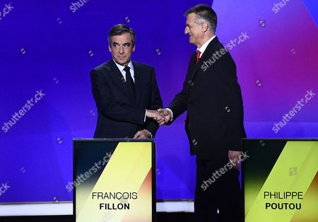 French presidential election candidate for the right-wing Les Republicains (LR) party Francois Fillon (L) shakes hands with French presidential candidate Jean Lassalle as they take part in a special political TV show entitled '15mn to convince' at the studios of French television channel France 2 in Saint-Cloud, west of Paris, France, 20 April 2017, a few days ahead of the first round of the presidential election. France holds the first round of the 2017 presidential elections on 23 April 2017.