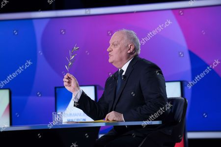 "French presidential election candidate for the Popular Republican Union (UPR) party Francois Asselineau takes part in a special political TV show entitled ""15mn to convince"" at the studios of French television channel France 2 in Saint-Cloud, west of Paris, on April 20, 2017, a few days ahead of the first round of the presidential election."