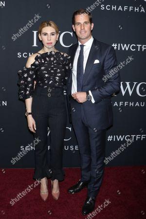 Zosia Mamet and Christoph Grainger-Herr, CEO of IWC Schaffhausen