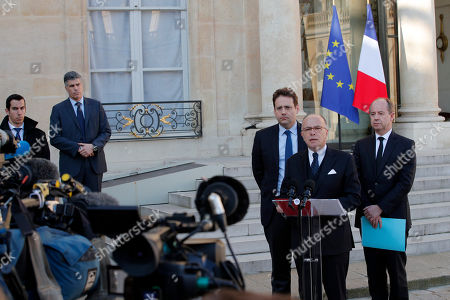 France's Interior Minister Matthias Fekl, left, Justice minister Jean-Jacques Urvoas, right, and Prime Minister Bernard Cazeneuve speak to the media after a defense and security council meeting at the Elysee Palace, in Paris, . France began picking itself up from another fatal shooting claimed by the Islamic State group, with President Francois Hollande calling together his security council and with his would-be successors treading carefully before the election this weekend