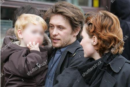 Mark Owen carrying son, Elwood Jack with fiancee Emma Ferguson leaving the Electric restaurant