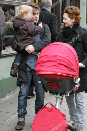 Mark Owen carrying son, Elwood Jack as finacee, Emma Ferguson pushes baby, Willow Rose in the buggy after leaving the Electric restaurant