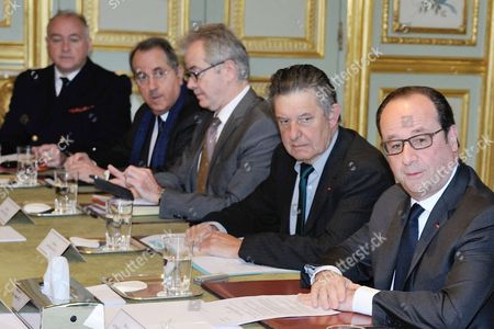 French president Francois Hollande holding a security council with foreign affair minister Jean-Marc Ayrault, Interior minister Matthias Fekl, Defense minister Jean-Yves Le Drian, justice minister Jean-Jacques Urvoas after the terrorist attack on the Champs Elysees.