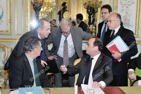 French president Francois Hollande holding a security council with foreign affair minister Jean-Marc Ayrault, Interior minister Matthias Fekl, Defense minister Jean-Yves Le Drian, justice minister Jean-Jacques Urvoas, Jean-Pierre Jouyet after the terrorist attack on the Champs Elysees.