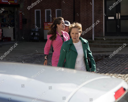 Sally Metcalfe is, as played by Sally Dynevor, shocked when Gina Seddon, as played by Connie Hyde, approaches telling her how sorry she is. Leah, as played by Molly McGlynn, quickly intercepts and bundles Gina into her car before she can say any more. (Ep 9159 - Mon 8 May 2017)