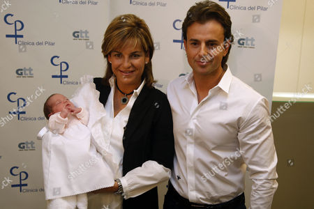 Arantxa Sanchez Vicario and husband Jose Santacana with their newborn baby
