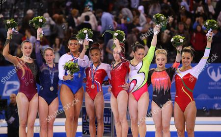 Elissa 'Ellie' Downie (3-L) of Britain is flanked by second placed Zsofia Kovacs (2-L) of Hungary and third placed Melanie de Jesus dos Santos (4-L) of France on the podium after winning the gold medal in the women's All-Around final during the 2017 Artistic Gymnastics European Championships at Polivalenta Sports Hall in Cluj-Napoca, Romania, 21 April 2017. Others are Nina Derwael (L) of Belgium, Elena Eremina (4-R) of Russia, Kim Bui (3-R) of Germany, Martina Maggio (2-R) of Italy, and Ana Filipa Martins (R) of Portugal.