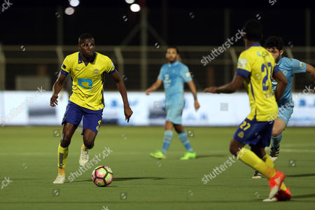 Al-Nassr player Omar Hawsawi (L) in action for the ball with Al-Batin player Sultan Ghunaiman (R) during the Saudi Professional League soccer match between Al-Batin and Al-Nassr at Al-Batin Club Stadium, Hafr Al-Batin, Saudi Arabia, 21 April 2017.