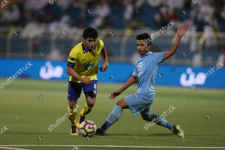 Al-Nassr player Yahya Al-Shehri (L) in action for the ball with Al-Batin player Waleed Hezam (R) during the Saudi Professional League soccer match between Al-Batin and Al-Nassr at Al-Batin Club Stadium, Hafr Al-Batin, Saudi Arabia, 21 April 2017.