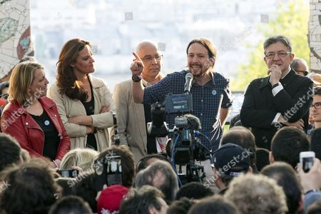 (L-R) French left-wing politician Danielle Simonnet, member of the Portuguese Left block Marisa Matias, Spain's Podemos leader Pablo Iglesias and French presidential election candidate for the far-left coalition La France insoumise Jean-Luc Melenchon deliver a speech during a meeting of the candidate in Paris, France, 21 April 2017.