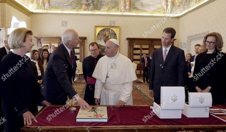 Pope Francis exchanges gifts with Prince Hans-Adam of Liechtenstein, (2-L), his wife Princess Marie, (L), Hereditary Prince Alois of Liechtenstein, (2-R), and his wife Princess Sophie of Liechtenstein (R), on the occasion of their private audience, at the Vatican, 22 April 2017.
