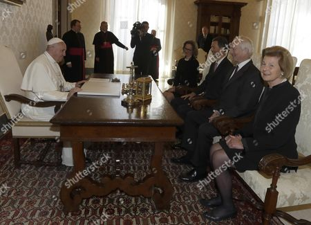 Stock Image of Pope Francis sits at a table with Hereditary Prince Alois of Liechtenstein, (3-R), his wife Princess Sophie of Liechtenstein, (4-R), Prince Hans-Adam, (2-R), and Princess Marie, (R), on the occasion of their private audience, at the Vatican, 22 April 2017.
