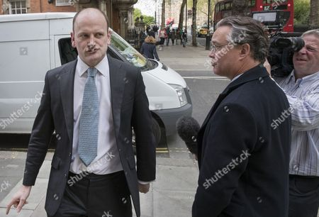 Former Conservative and UKIP MP Douglas Carswell talks to reporters near Parliament after it was announced that he will not contest his Clacton-on-Sea parliamentary seat in the geneneral election