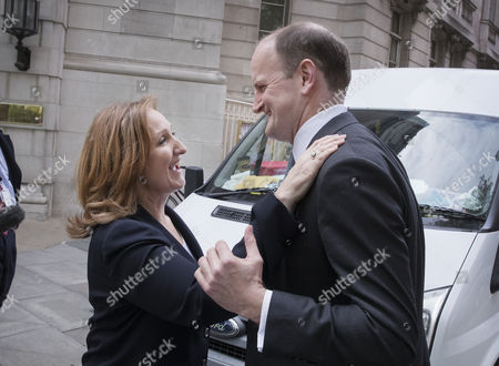 Former Conservative and UKIP MP Douglas Carswell is greeted by former UKIP leadership challenger and MEP Suzanne Evans near Parliament after it was announced that he will not contest his Clacton-on-Sea parliamentary seat in the geneneral election