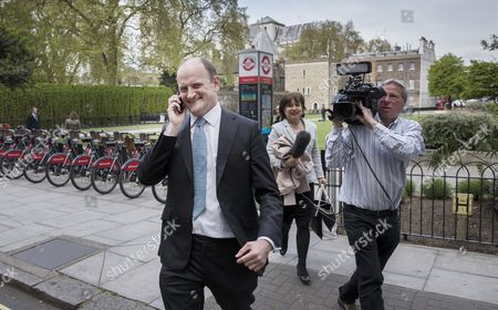 Former Conservative and UKIP MP Douglas Carswell is chased by ITV news' Libby Wiener near Parliament after it was announced that he will not contest his Clacton-on-Sea parliamentary seat in the geneneral election