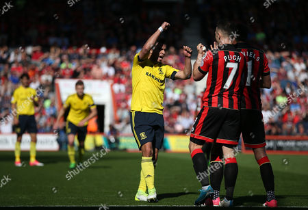 Fabio Da Silva of Middlesbrough clashes with Marc Pugh of Bournemouth and Charlie Daniels of Bournemouth   during the Premier League match between Bournemouth and  Middlesbrough  played at Vitality Stadium  , Bournemouth    on 22nd April  2017