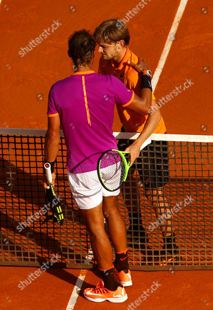 David Goffin of Belgium shakes hands with Rafael Nadal of Spain on Court Rainier III at the Monte-Carlo Rolex Masters, Monte-Carlo, France on Saturday, April 22nd, 2017