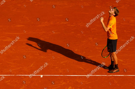 David Goffin of Belgium looks up as planes fly over on Court Rainier III at the Monte-Carlo Rolex Masters, Monte-Carlo, France on Saturday, April 22nd, 2017