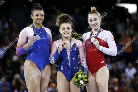 Coline Devillard (C) of France poses with her gold medal on the podium after winning the women's Vault final during the 2017 Artistic Gymnastics European Championships at Polivalenta Sports Hall in Cluj-Napoca, Romania, 22 April 2017. Devillard won ahead of second placed Elissa 'Ellie' Downie (L) of Great Britain and third placed Boglarka Devai (R) of Hungary.