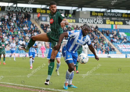 Plymouth's Jake Jervis battles for the ball with Colchester United's George Elokobi during the Sky Bet League 2 match between Colchester United and Plymouth Argyle on Saturday 22nd April 2017 at Weston Homes Community Stadium , Colchester, Essex