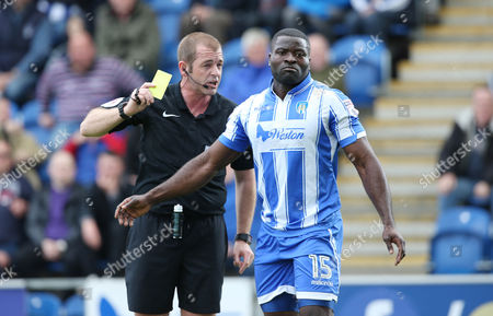 Colchester United's George Elokobi is shown a yellow card from Referee Darren Handley during the Sky Bet League 2 match between Colchester United and Plymouth Argyle on Saturday 22nd April 2017 at Weston Homes Community Stadium , Colchester, Essex