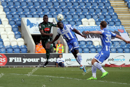 George Elokobi of Colchester United heads the aerial ball when under pressure from Jordan Slew of Plymouth Argyle during Colchester United vs Plymouth Argyle, Sky Bet EFL League 2 Football at the Weston Homes Community Stadium on 22nd April 2017