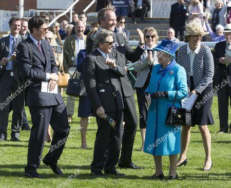 Queen Elizabeth II joined buy John Warren, Jake Warren, Harry Herbert and Lady Carolyn Warren celebrate as her horse Call to Mind won the Dubiai Duty Free Maiden Stakes.