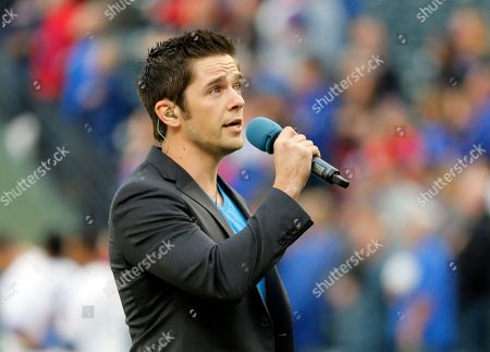 """Singer Tim Urban of """"American Idol"""" sings the national anthem before a baseball game between the Kansas City Royals and the Texas Rangers in Arlington, Texas"""