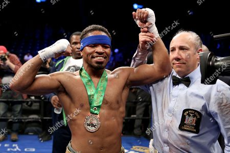 Shawn Porter celebrates after defeating Andre Berto during their welterweight fight on in Brooklyn, NY. Porter won via 9th round TKO